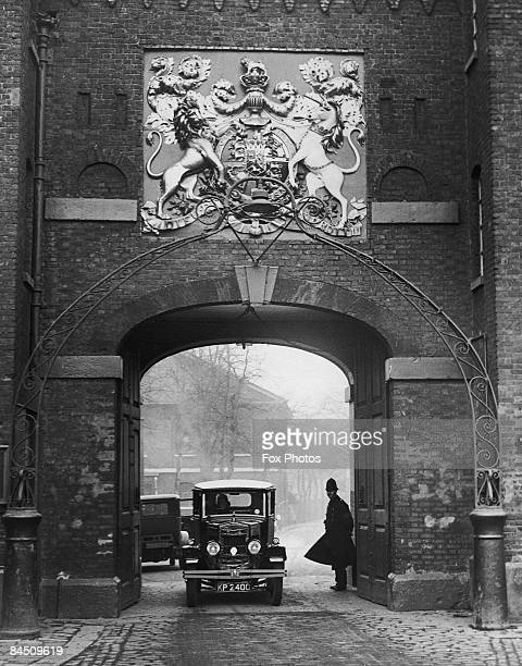The gateway entrance to Chatham Dockyard in Kent circa 1930 The coat of arms of King George III bears the mottoes 'Dieu et Mon Droit' and 'Honi Soit...