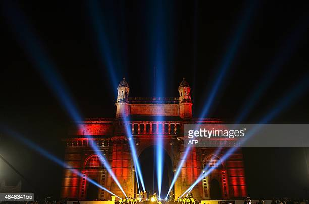 The Gateway of India monument is seen illuminated as a part of a new state tourism initiative ahead of Republic Day celebrations in Mumbai on January...