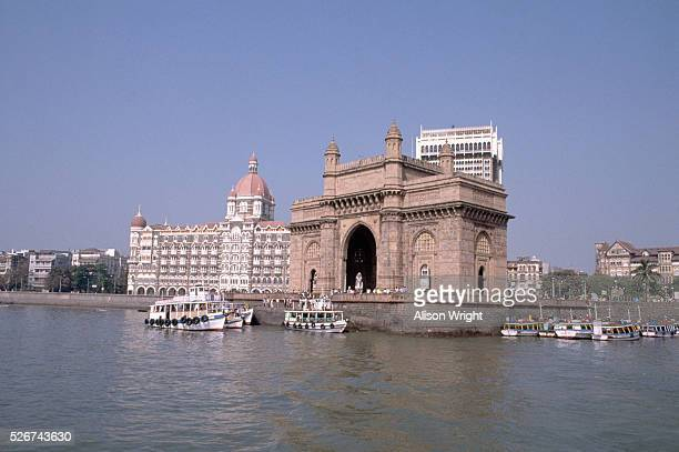 The Gateway to India stands on the walls of the port in Bombay India Built in 1924 the arch stands as a landmark to the city