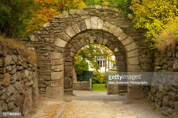 the gateway to the monastic city of glendalough closeup - arch stock pictures, royalty-free photos & images