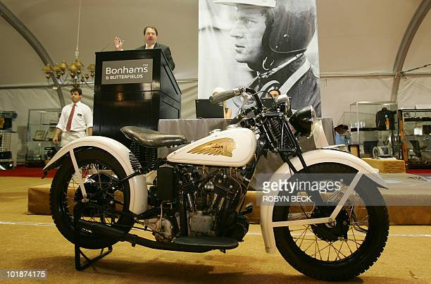 The gavel falls on a 1934 Indian Sport Scout motorcycle from the Steve McQueen collection during an auction of items belonging to the late and...