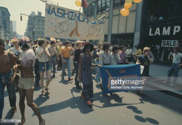 The Gay Activists Alliance take part at an LGBT parade through New York City on Christopher Street Gay Liberation Day 1971 Behind them are the...