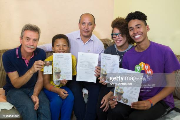 The gay couple constituted by Brazilian Toni Reis and British David Harrad and their adopted children Filipe Jessica and Alyson pose for a picture...
