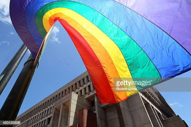 The Gay Pride Flag swirls in the wind before being hoisted atop the flagpole at Boston City Hall during the 20th annual flagraising ceremony to open...