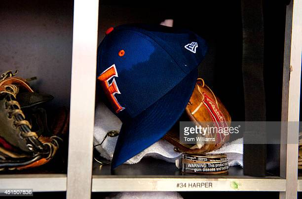 The gear of Rep Tom Rooney RFla sits in the cubbyhole of the National's Bryce Harper during the 53rd Congressional Baseball Game in Nationals Park...