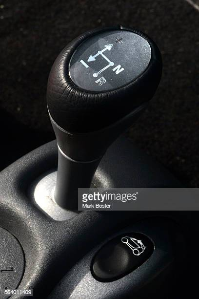 –The gear shift on the Smart car is simple and allows the driver forward reverse and an automatic shiftThe Smart car is a tiny sub–compact made in...