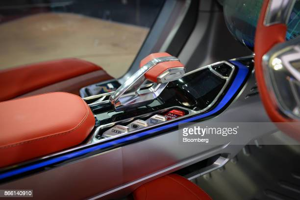 The gear stick and central console of a Suzuki Motor Corp eSurvivor compact sports utility vehicle is seen at the Tokyo Motor Show in Tokyo Japan on...