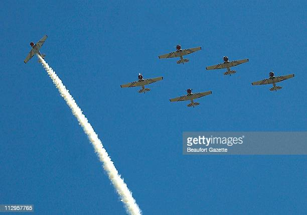 The GEICO Sky Typers fly in missing man formation as Taps plays during a moment of silence at the opening of the Air Show Sunday April 22 for the...