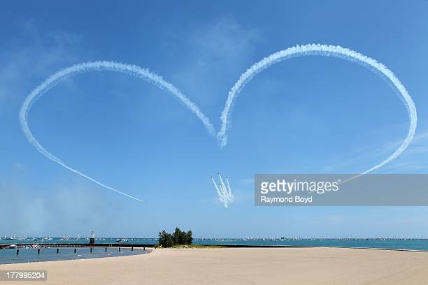 The GEICO Skytypers performs during the 55th Annual Chicago Air Water Show over North Avenue Beach in Chicago Illinois on AUGUST 17 2013