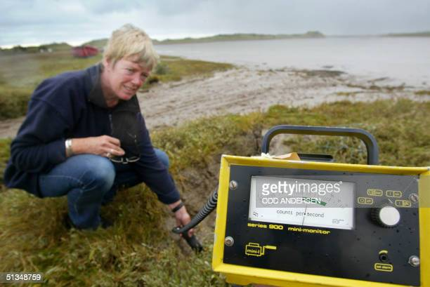The Geiger counter of Janin Allis-Smith from Cumbrian's opposed to radioactive environment and Greenpeace shows almost 200 counts in the mud which...