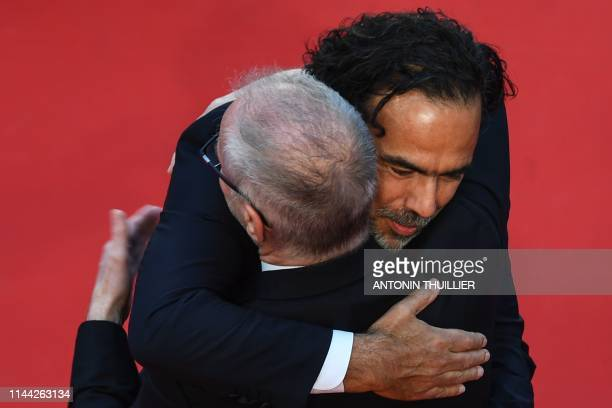 The General Delegate of the Cannes Film Festival Thierry Fremaux embraces Mexican director and President of the Jury of the Cannes Film Festival...