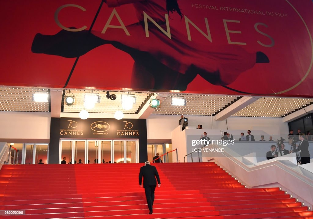 The General Delegate of the Cannes Film Festival Thierry Fremaux walks back to the Festival Palace on May 20, 2017 after the screening of the film '120 Beats Per Minute (120 Battements Par Minute)' at the 70th edition of the Cannes Film Festival in Cannes, southern France. /