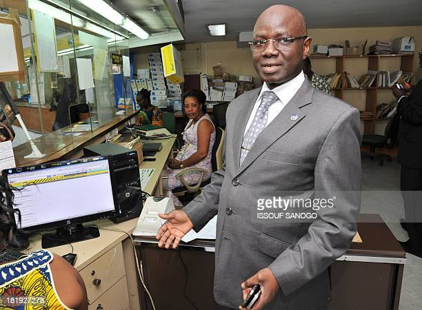 """The General Director of Ivory Coast's mail services """"La Poste,"""" Mamadou Konate, stands in the offices in Abidjan on September 26, 2013. AFP PHOTO /..."""