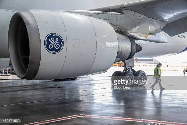 The General Electric Co. Logo sits on a GE Aviation CF6-80C jet engine as it hangs from the wing of an Airbus A300-600 Beluga super transporter...