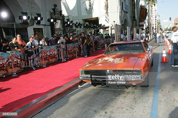 The General Lee a 1969 Dodge Charger muscle car arrives at the Premiere Of The Dukes of Hazzard at the Grauman's Chinese Theatre on July 28 2005 in...