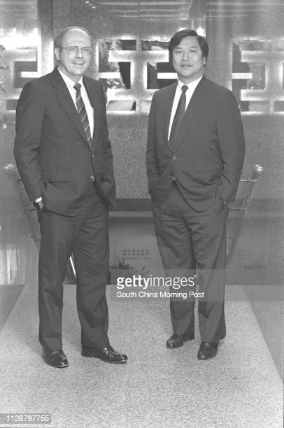 The General Manager of the International Bank of Asia Mr Michael Ipson and Assistant to the Managing Director Mr David Chan The Bank's loan portfolio...