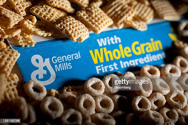 The General Mills Inc logo is surrounded by Cheerios and Corn Chex in this arranged photograph in Washington DC US on Friday Feb 17 2012 General...