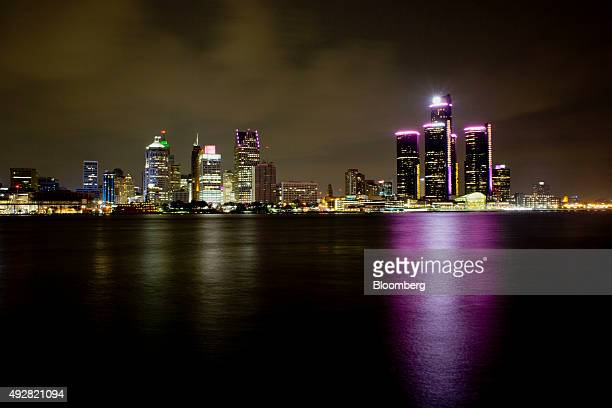 The General Motors Co Renaissance Center right stands in the skyline of downtown Detroit as seen from across the Detroit River in Windsor Ontario...