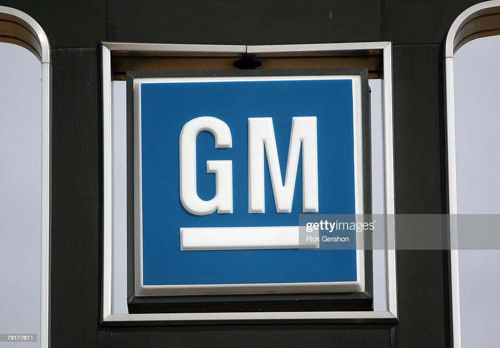 The General Motors Emblem Is Displayed On A Sign At The El