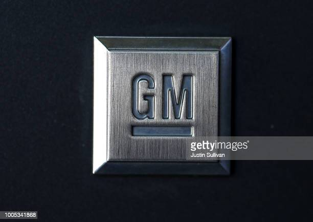 The General Motors logo is displayed on a car a Chevrolet dealership on July 25 2018 in Colma California General Motors lowered its profit forecasts...