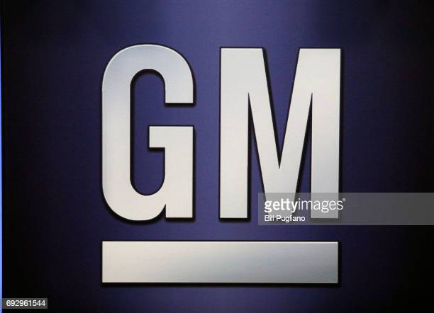 The General Motors logo is shown on the podium at the company's annual meeting of shareholders June 6 2017 in Detroit Michigan The results of a fight...