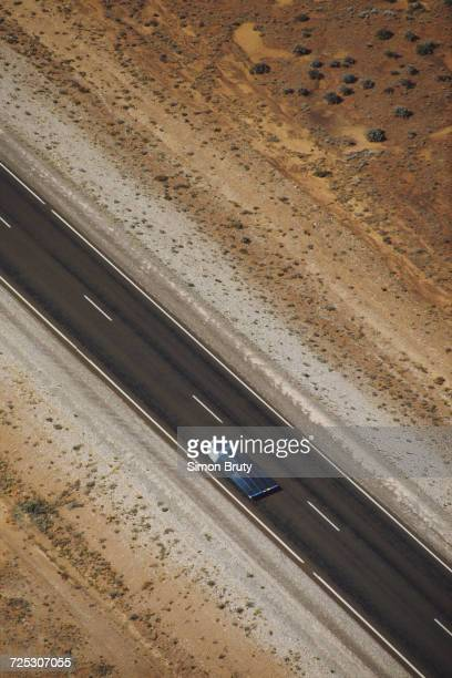 The General Motors Sunraycer solar-powered car drives on Stuart Highway during the inaugural Darwin to Adelaide Pentax World Solar Challenge race on...
