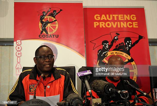 The general secretary of the Congress of South African Trade Unions Zwelinzima Vavi flanked by COSATU president Sdumo Dlamini gives a press...