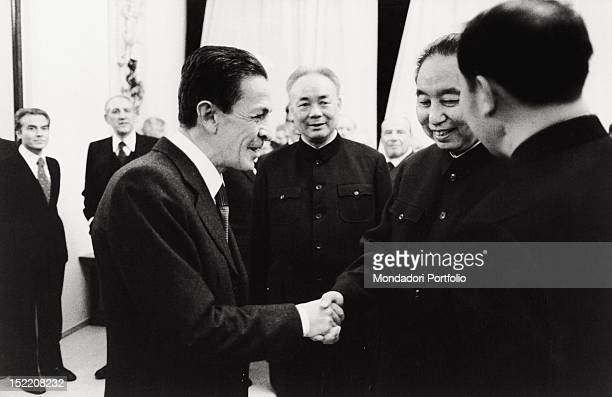 The General Secretary of the Italian Communist Party Enrico Berlinguer shaking hands with some Chinese politicians under the eyes of the Italian...