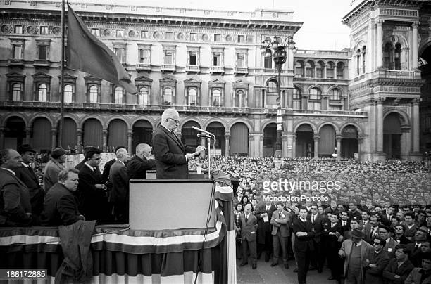 The General Secretary of the Italian Communist Party Luigi Longo reading on the stage at a meeting in Piazza del Duomo during the electoral campaign...