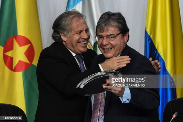 The General Secretary of the Organization of American States Uruguayan Luis Almagro greets Colombian Foreign Relation Minister Carlos Holmes Trujillo...