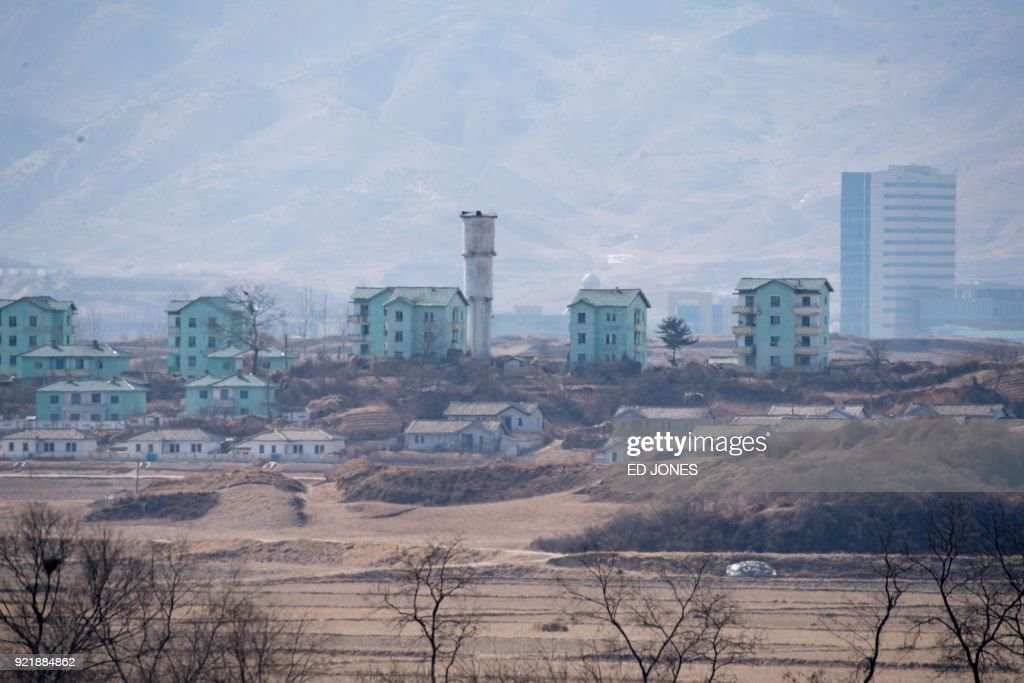 The general view shows a North Korean village near the truce village of Panmunjom, seen from within the Demilitarized Zone (DMZ) separating North and South Korea on February 21, 2018. / AFP PHOTO / Ed JONES