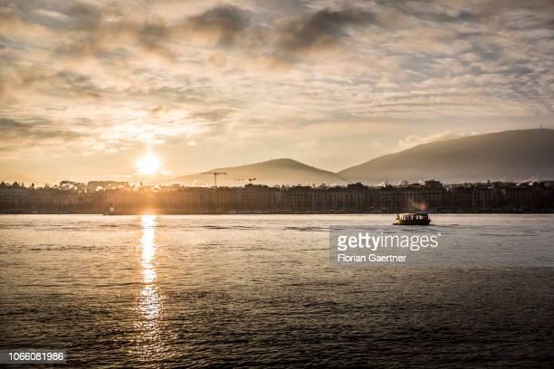 The Geneva lake is pictured in front of the rising sun on November 28 2018 in Geneva Switzerland