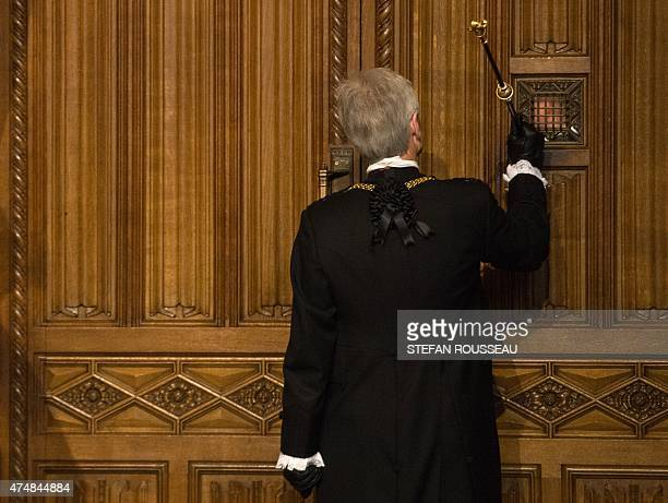 The Gentleman Usher of the Black Rod LieutenantGeneral David Leakey knocks on the door to the House of Commons in the Members' Lobby to summon...