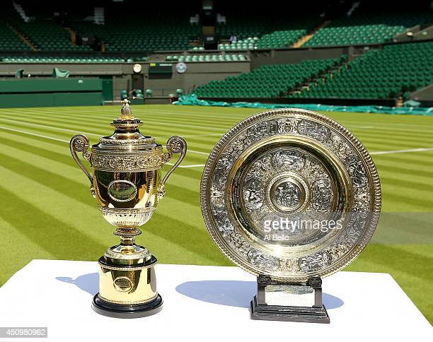 The Gentlemen's and Ladies' singles trophies are seen on Centre Court during previews at Wimbledon on June 21 2014 in London England