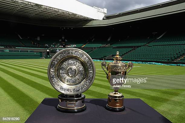 The Gentlemen's and Ladies' trophies are displayed on Centre Court during previews for Wimbledon Tennis 2016 at Wimbledon on June 25, 2016 in London,...