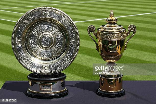 The Gentlemen's and Ladies' trophies are seen on centre court during previews for Wimbledon Tennis 2016 at Wimbledon on June 25 2016 in London England