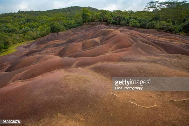 the geological formation 'seven coloured earths' - soil erosion stock photos and pictures