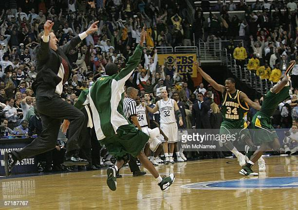 The George Mason Patriots celebrate their overtime victory over the Connecticut Huskies during the Regional Finals of the NCAA Men's Basketball...
