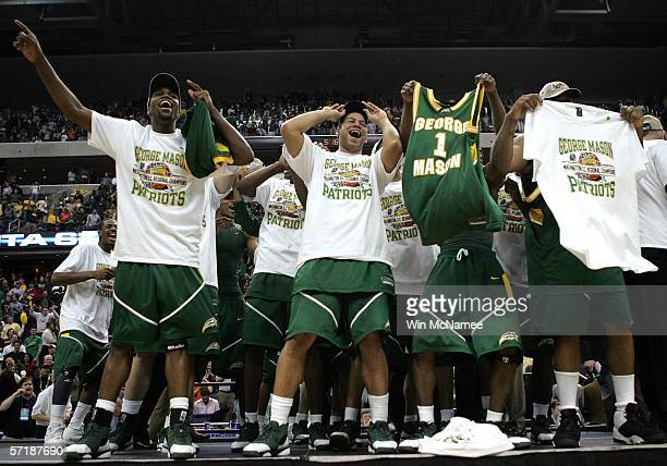 The George Mason Patriots celebrate their win over the Connecticut Huskies during the Regional Finals of the NCAA Men's Basketball Tournament on...