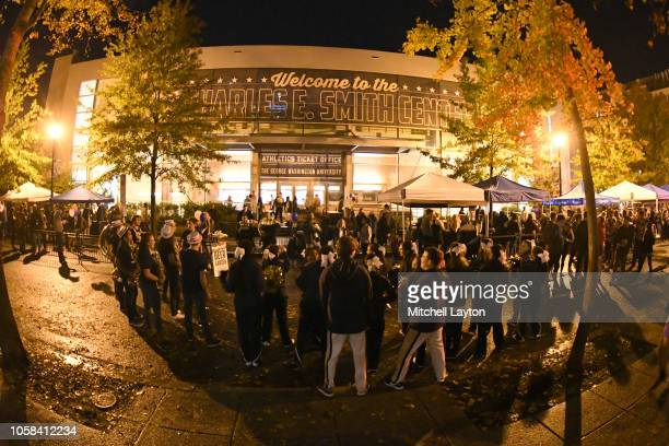 The George Washington Colonials fans enjoy a party outside of building before start of opening night a college basketball game against the Stony...