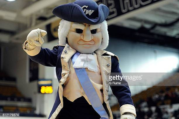 The George Washington Colonials mascot performs during the game against the St Peter's Peacocks at the Charles E Smith Athletic Center on December 19...