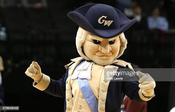 The George Washington Colonials mascot walks on the court in the second half against the Virginia Commonwealth Rams during the Semifinals of the 2014...