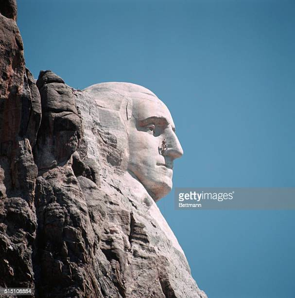 The George Washington section of Mount Rushmore is being repaired by workmen In this picture we see workmen repairing the nose