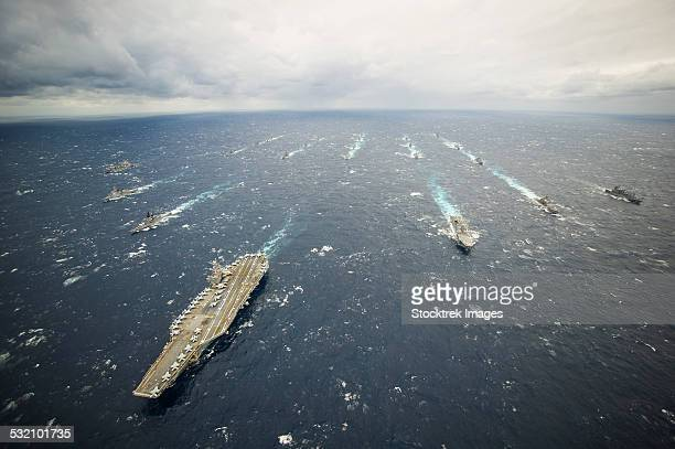 The George Washington Strike Group and Japan Maritime Self-Defense Force ships.