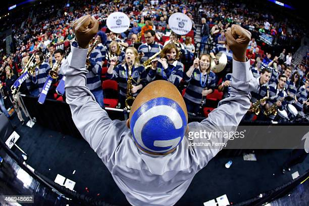 "The Georgetown Hoyas band performs as their conductor directs with a painted ""G"" on his head at halftime against the Eastern Washington Eagles during..."