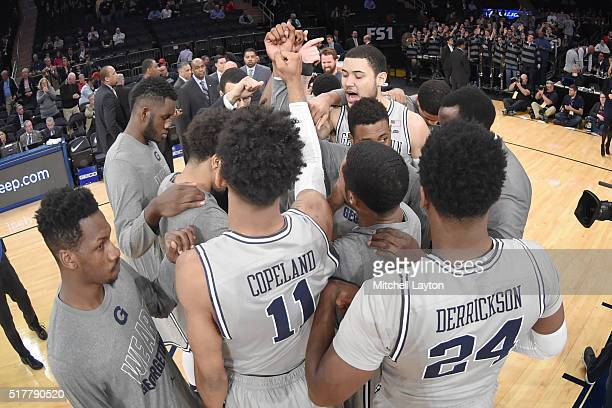 The Georgetown Hoyas huddle on the floor before the first round game of the Big East College Basketball Tournament against the DePaul Blue Demons at...