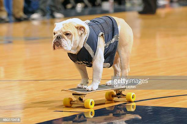 The Georgetown Hoyas mascot rides a skateboard on the floor during a college basketball game against the Kansas Jayhawks at the Verizon Center on...
