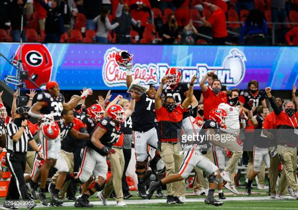 The Georgia Bulldogs bench reacts after the game winning field goal during the Chick-fil-A Peach Bowl against the Cincinnati Bearcats at...