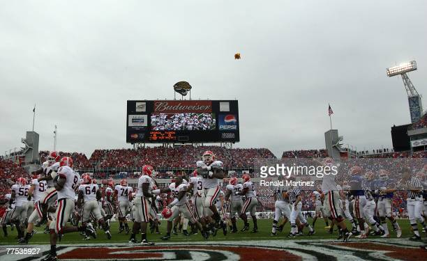 The Georgia Bulldogs celebrate a touchdown against the Florida Gators in the first quarter at Jacksonville Municipal Stadium on October 27 2007 in...