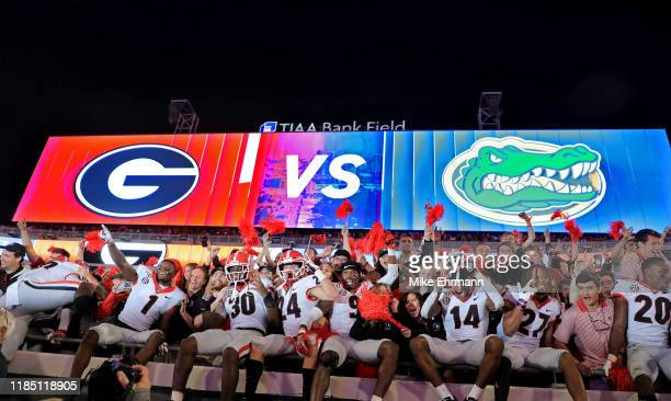 The Georgia Bulldogs celebrate after winning a game against the Florida Gators on November 02 2019 in Jacksonville Florida